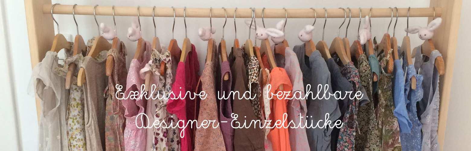 Kinder-Designerkleidung auf Kleiderstange